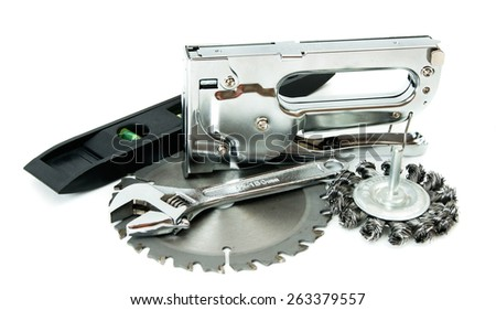 Metal working tools. Metalwork. Saw, spanner and others tools on white background. - stock photo
