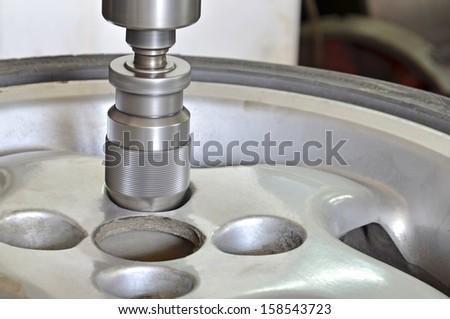 Metal workshop, Drill milling machine closeup. - Stock Image. Repairing car, van, truck aluminum tire - stock photo