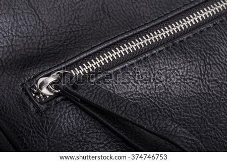 Metal zipper on the leather bag. Close-up, macro. - stock photo