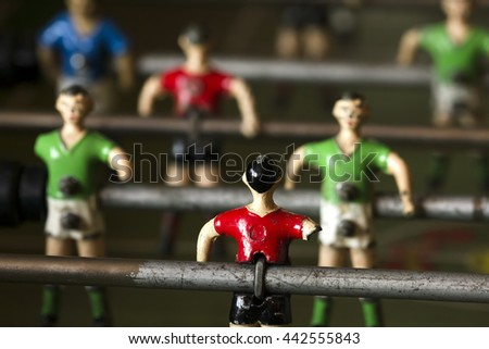 metalic soccer players of table football  with one arm only , selective focus ; concept disabled sport - stock photo