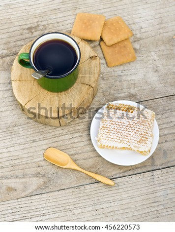 metall cup of tea with honey and cockies on wooden background - stock photo