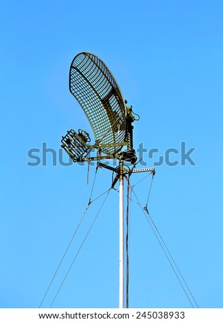 Metallic antenna on the background of blue sky - stock photo