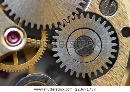 Metallic Background with metal cogwheels a clockwork. Macro  - stock photo