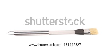 Metallic barbeque brush. Isolated on a white background - stock photo