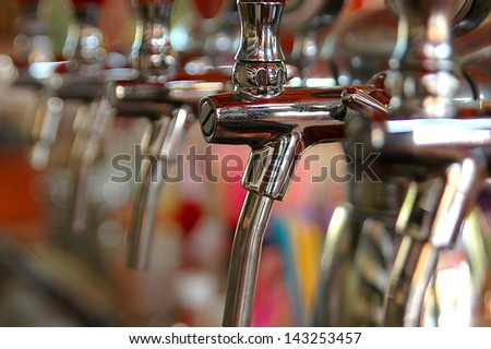 Metallic beer taps - stock photo