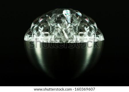 Metallic bowl full of soap bubbles isolated on black - stock photo