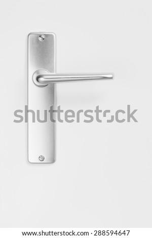 metallic door handle, white background - stock photo