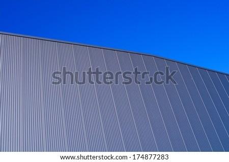 Metallic facade of a warehouse - stock photo