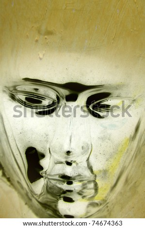 Metallic face with grunge background - stock photo
