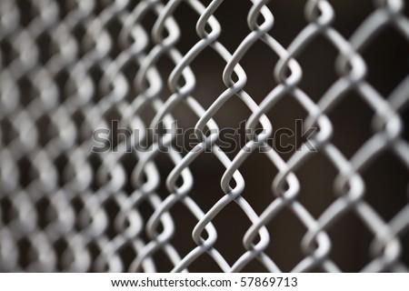 metallic net with black background - stock photo