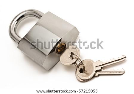 Metallic padlock with three keys in keyhole isolated on white - stock photo