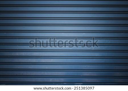 metallic roller shutter door for background - stock photo
