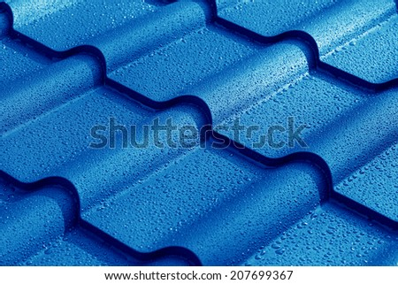 Metallic roof with drops of water. - stock photo