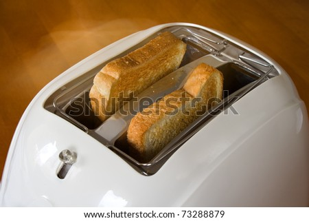 Metallic toaster and two hot toasts ready to serve for the breakfast. - stock photo