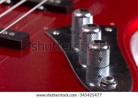 Metallic volume bass treble guitar bass knobs. - stock photo