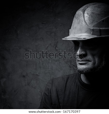metallurgist portrait on dark background - stock photo