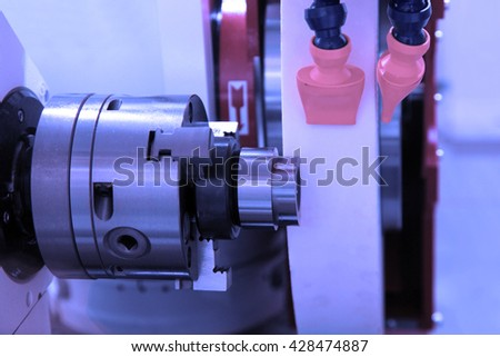 metalworking industry: finishing metal working on lathe grinder machine  - stock photo
