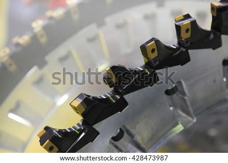 Metalworking industry. Teeth large diameter cutter - stock photo