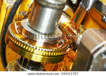 metalworking industry. tooth gear cogwheel machining by hob cutter mill tool - stock photo