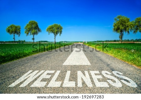 metaphor illustrating on the road the wellness and good health - stock photo