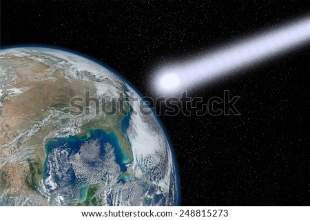 Meteorite close to collide with the Earth as a concept of the end of the world. Elements of this image furnished by NASA - stock photo