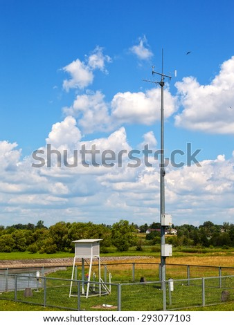 Meteorological station on the background river of Wieprz. - stock photo