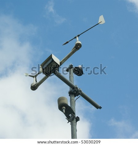 meteorology measuring equipment over blue cloudy sky - stock photo