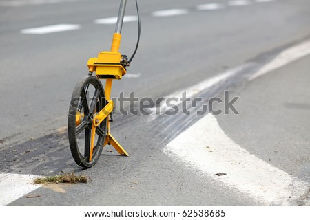 Meter measuring wheels, used to measure distance. Used by police for accident footage - stock photo