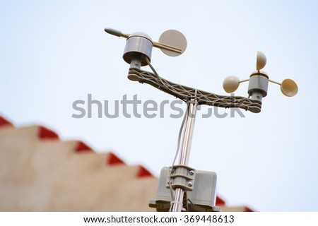 Meterological weather station wind meter anemometer on sky background - stock photo