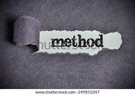 method word under torn black sugar paper  - stock photo