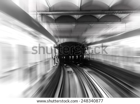 Metro subway rails with motion blur effect - stock photo