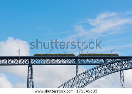 Metro Train on the Bridge Built by Eiffel in Porto - stock photo