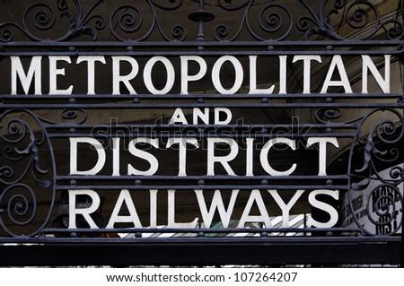 Metropolitan and district railways sign in London, UK - stock photo