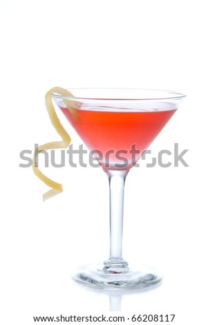 Metropolitan cocktail with vodka, triple sec, red cranberry juice, lime and lemon spiral isolated on a white background - stock photo