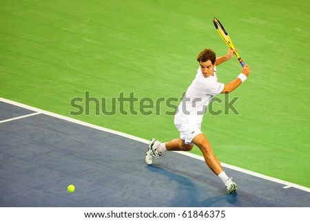 METZ, FRANCE - SEPTEMBER 23: Richard Gasquet (FRA, ATP No. 30) and Edouard Roger-Vasselin (France, not pictured) reach the doubles semifinals of the ATP Open de Moselle on September 23, 2010 in Metz. - stock photo