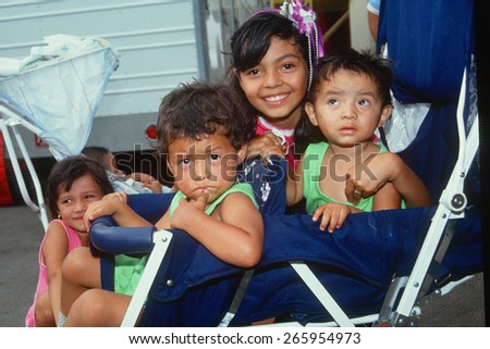 Mexican American children in a stroller, Los Angeles, CA - stock photo