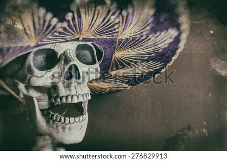 Mexican Bandit Skeleton 1. A skeleton wearing a Mexican sombrero. Edited in a vintage film style. - stock photo