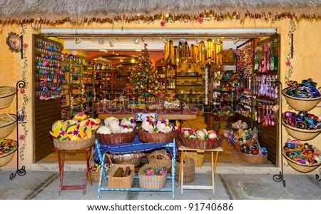Mexican (caribbean) souvenir shop (bazaar) at Playa del Carmen city. - stock photo