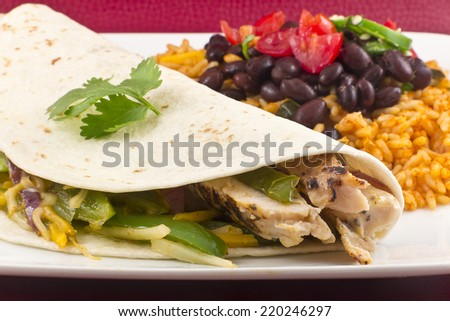 Mexican chicken fajita with green bell pepper slices and red onion in ...