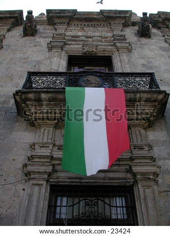Mexican flag hanging from a beautiful building in Guadalajara, Mexico. - stock photo