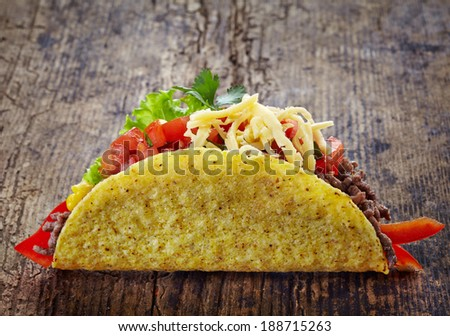 Mexican food Taco on old wooden table - stock photo