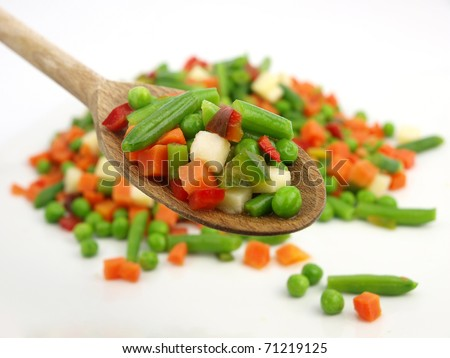 Mexican frozen vegetables on a wooden spoon - stock photo