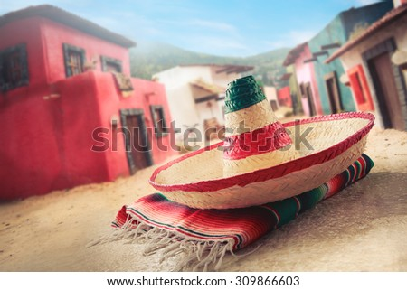 """Mexican hat """"sombrero"""" on a """"serape"""" in a mexican town - stock photo"""