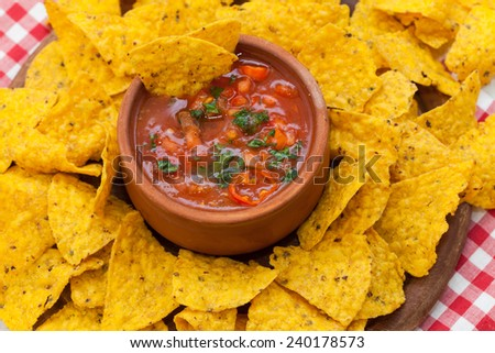 Mexican nacho chips and salsa dip in bowl - stock photo