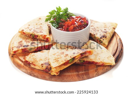 Mexican quesadillas with cheese, vegetables and salsa isolated on white - stock photo