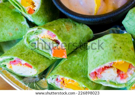 Mexican restaurant offering a gluten-free alternative to their traditional cuisine with these vegan veggie vegetarian wraps. - stock photo