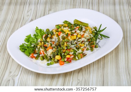 Mexican rice with vegetables and salad leaves - stock photo