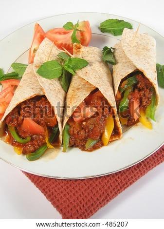 mexican style food (fajitas) overhead shot of mexican beef fajitas - stock photo