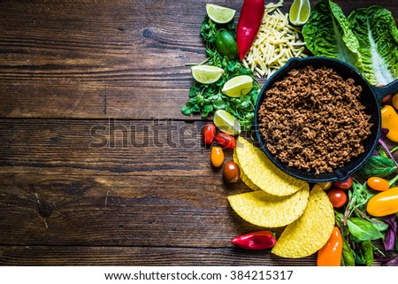 MExican tacos on wooden board, text space for recipe. From above, vibrant colors. - stock photo