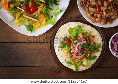 Mexican tacos with meat, beans and salsa. Top view - stock photo